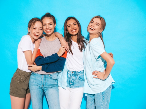 four-young-beautiful-smiling-hipster-girls-trendy-summer-clothes-sexy-carefree-women-posing-near-blue-wall-studio-positive-models-having-fun-hugging_158538-3740 (1).jpg