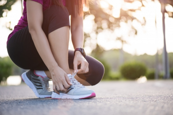 woman-tying-shoe-laces-getting-ready-jogging-garden-background_53476-3861.jpg